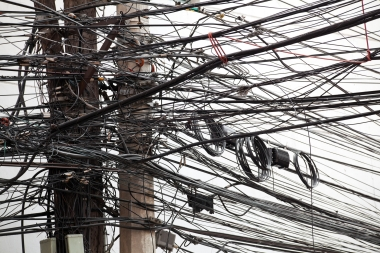 Power lines on utility poles in a chaotic mess.
